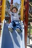 Gelukkige Jongen bij Speelplaats Stock Afbeeldingen