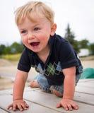 Gelukkige jongen bij speelplaats Royalty-vrije Stock Afbeeldingen