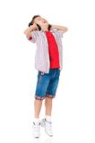 Gelukkige jongen met hoofdtelefoons Stock Foto