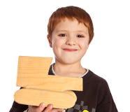 Gelukkige jongen met nieuw stuk speelgoed Stock Afbeeldingen