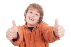 Gelukkige jongen met omhoog duimen Stock Afbeelding