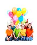 Gelukkige jongens en meisjes met gekleurde ballons Stock Foto's