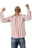 Gelukkige kerel die goed nieuws viert Stock Foto