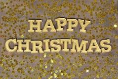 Gelukkige Kerstmis gouden tekst en gouden sterren Stock Afbeelding