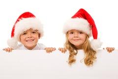 Gelukkige Kerstmisjonge geitjes met wit geïsoleerdw teken - Stock Afbeelding