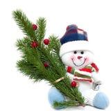 Gelukkige Kerstmissneeuwman met spar Stock Foto