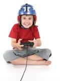 Gelukkige kind speelspelen stock foto's