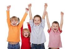 Gelukkige kinderen met hun omhoog handen Stock Foto's