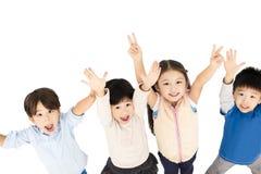 gelukkige kinderen met omhoog handen stock foto's