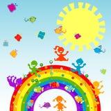 Gelukkige kinderen op een regenboog Stock Afbeeldingen
