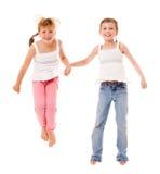 Gelukkige kleine zusters stock foto's