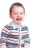 Gelukkige lachende babyjongen die op wit wordt geïsoleerd royalty-vrije stock foto