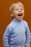 Gelukkige lachende jongen Stock Foto