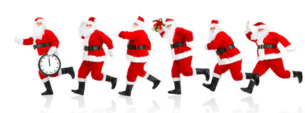 Gelukkige lopende Kerstmis Santas Royalty-vrije Stock Afbeelding