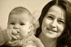 Gelukkige mamma en baby Stock Afbeelding