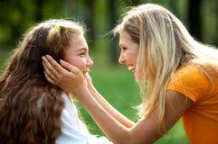 Gelukkige mamma en dochter Stock Foto's