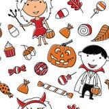 Gelukkige meisje en jongen in Halloween-kostuums met snoepjes naadloze pa Royalty-vrije Stock Afbeeldingen
