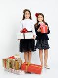 Gelukkige meisjes met giften Stock Afbeelding