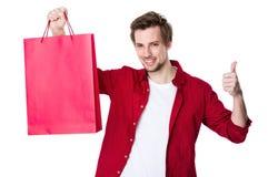 Gelukkige mens die met zijn omhoog duimen winkelen royalty-vrije stock afbeeldingen