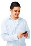 Gelukkige Mens die Mobiele Telefoon met behulp van Stock Foto