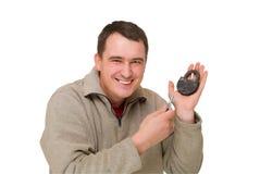 Gelukkige mens met de sleutel en het slot stock fotografie