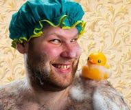 Gelukkige mens met eendstuk speelgoed royalty-vrije stock foto