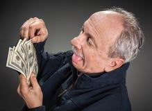 Gelukkige mens met geld stock fotografie