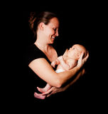 Gelukkige moeder en babyzuigeling royalty-vrije stock foto