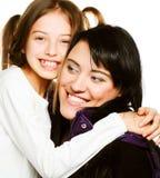Gelukkige moeder en haar dochter over witte achtergrond Royalty-vrije Stock Fotografie
