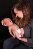Gelukkige moeder met babyjongen stock afbeeldingen