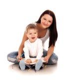 Gelukkige moeder met een kind Stock Afbeeldingen