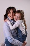 Gelukkige moeder met haar dochter Stock Foto's