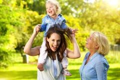 Gelukkige moeder met kind en grootmoeder royalty-vrije stock foto's