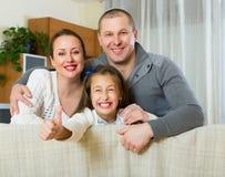 Gelukkige moeder, vader en dochter Stock Foto