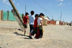 Gelukkige Mongoolse Jonge geitjes Stock Afbeeldingen