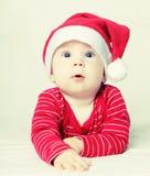 Gelukkige Nieuwjaarbaby in Kerstmanhoed, Kerstmis Royalty-vrije Stock Afbeelding