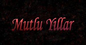 Gelukkige Nieuwjaartekst in Turkse Mutlu Yillar-draaien aan stof van Stock Foto's