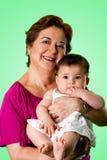 Gelukkige oma en leuke baby Stock Afbeeldingen