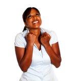 Gelukkige opgewekte jonge vrouw die een overwinning viert Royalty-vrije Stock Foto's