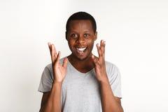 Gelukkige opgewekte zwarte mens, gelaatsuitdrukking, menselijke emoties stock foto's