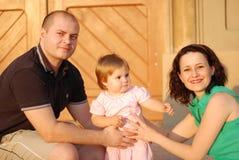 Gelukkige ouders en dochter Stock Foto