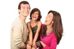 Gelukkige ouders en hun kind in studio royalty-vrije stock foto's