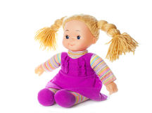 Gelukkige pop met vlechten in roze kleding Royalty-vrije Stock Foto