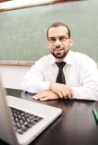 Gelukkige positieve leraar met laptop Royalty-vrije Stock Afbeeldingen
