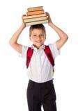 Gelukkige schooljongen die zich met boek bevinden Stock Foto's