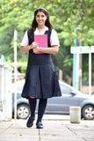 Gelukkige Studente Walking To School royalty-vrije stock afbeeldingen