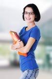 Gelukkige studentenvrouw met notitieboekjes Stock Fotografie