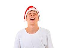 Gelukkige tiener in de hoed van de Kerstman Royalty-vrije Stock Foto's