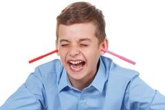 Gelukkige Tiener De potloden knoeien thuis Grappige manier om pret te hebben Royalty-vrije Stock Afbeelding