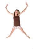 Gelukkige tiener die in de lucht springt Royalty-vrije Stock Foto